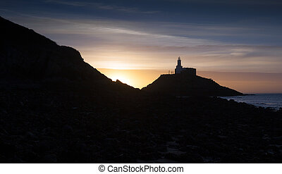 Sunrise at Mumbles lighthouse - An early morning silhouette...