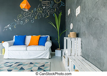 Living room with chalkboard wall