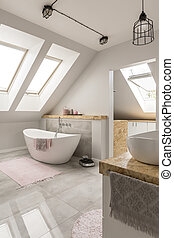 Freestanding bath in marble bathroom - Oval freestanding...