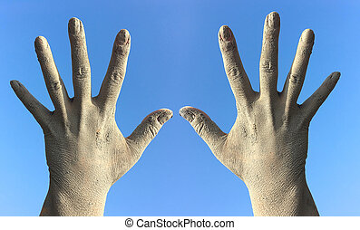 Two female hands in the dirt and dust from the splayed...