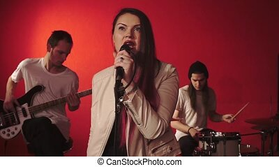 Music group on red background - Music group. Singer...