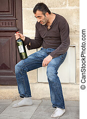 alcohol addiction - drunk alcoholic man standing near house...