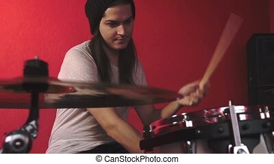 Portrait of drummer on red bacground HD