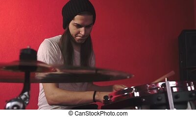 Portrait of drummer on red bacground