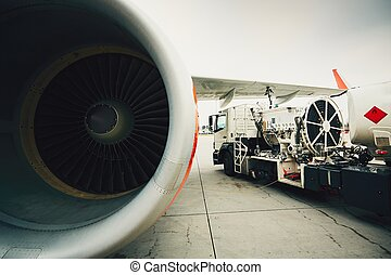 Refueling the aircraft - Process of the refueling passenger...
