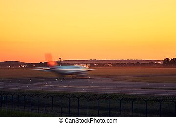 Airplane taxiing to the runway - Golden sunset at the...