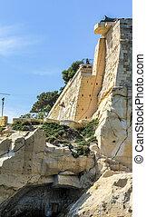 city wall of  La Valetta, Malta under blue sky