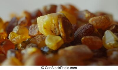 Beautiful Fiery Amber In Macro. From the Baltic Sea,...