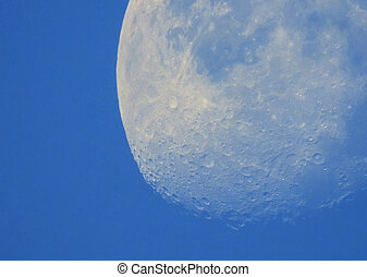 Phase of the moon in daytime.