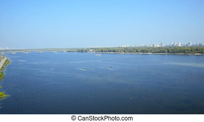 Aerial view from copter Bridge through the Dnipro river in Kiev