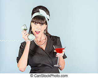 Retro Woman in Black Dress with Cosmopolitan and Phone Receiver