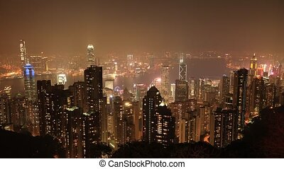 Victoria Peak by night - Aerial view time lapse of Victoria...