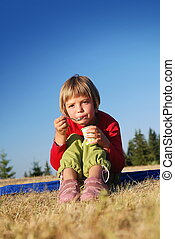 cute little girl eating healthy food outdoor - happy llittle...