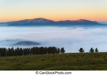 Sunrise at Urkiola over a foggy valley