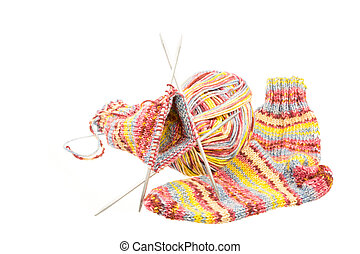 Isolated woolen socks with knitting equipment - Isolated...
