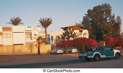 Car goes on the Road to Egypt and the Arabic Sign