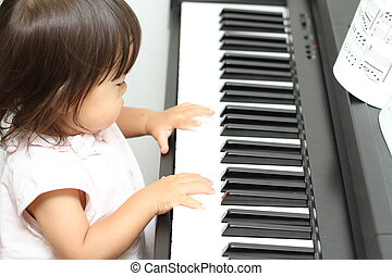 Japanese girl playing a piano (1 year old)