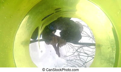 View from a bottom of a plastic bucket in which the man.
