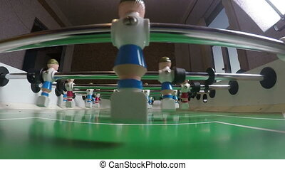 Toy football players beat off a goal.