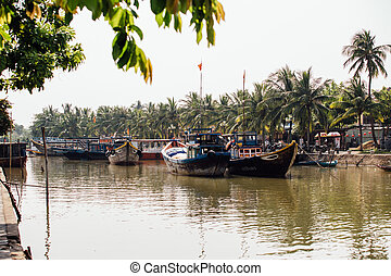 small dirty river with boats and bridges in Asia nice view.