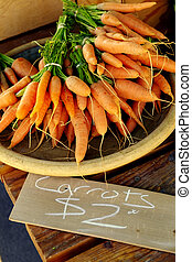 Pile of Fresh Carrots for Sale - Plate of fresh carrots for...