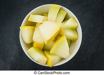 Portion of Yellow Honeydew Melon (selective focus) - Portion...