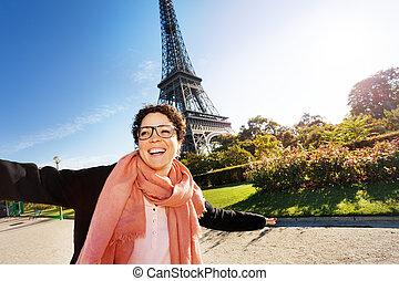 Portrait of happy young woman visiting Paris