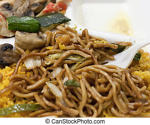Takeout - Terriyaki noodles over fried rice with mushrooms...