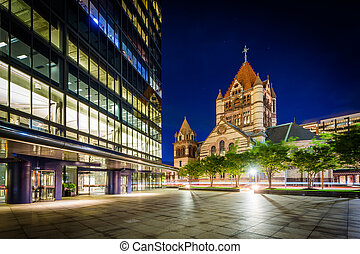 Trinity Church and a modern building at Copley at night, in...