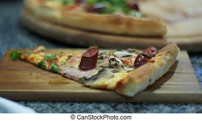 Pizza on a Wooden Platter in the Pizzeria