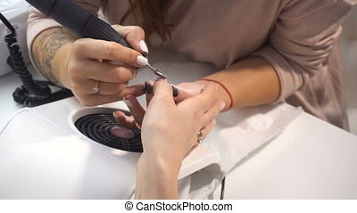 Manicure artist making professional manicure in spa salon....