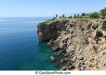 Cliffs of Antalya at the Mediterranian Sea in Turkey -...