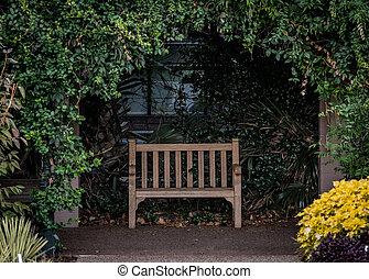 Park Bench in Alcove in outdoor garden