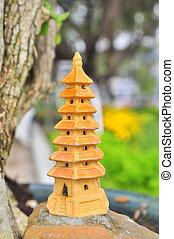 A bonsai temple tower