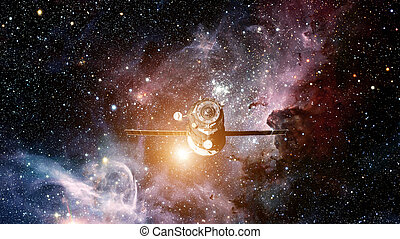 Spacecraft Progress orbiting the space. Elements of this...