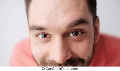 happy smiling man with beard having fun at camera - emotion,...