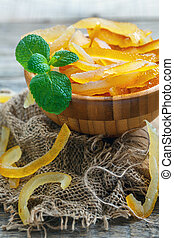 Delicious candied citrus fruit and a sprig of mint.