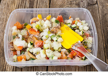 Frozen vegetables in a plastic container