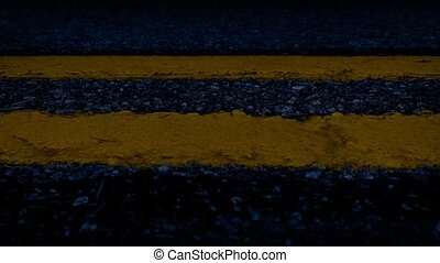 Passing Road Lines In The Dark - Slowly moving along yellow...