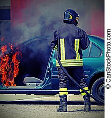 firefighter during shutdown of a fire of a car after car...