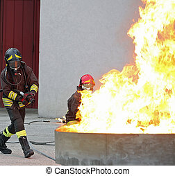 Firefighters during a training exercise off a huge fire in...