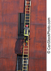 chief of the fire department as it climbs up the ladder...