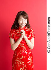 beauty woman wear cheongsam and smile to you in chinese new...