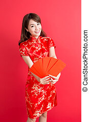 beauty woman wear cheongsam and take Red envelopes in...