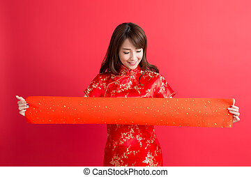 beauty woman wear cheongsam and show couplets with chinese...