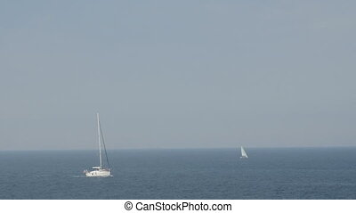 A sailboats on the horizon in the beautiful Mediterranean Sea