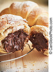 Croissant with chocolate filling - Closeup of croissant with...
