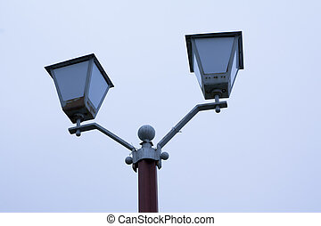 Old street light. Vintage street light on sky background.