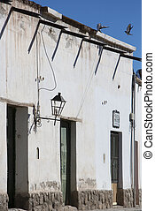 Colonial architecture in Cachi, blue sky and birds....
