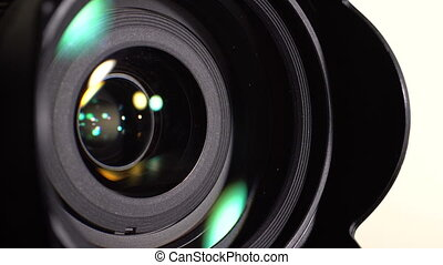 The lens of the camera. Close-up - Lens DSLR camera. Opening...